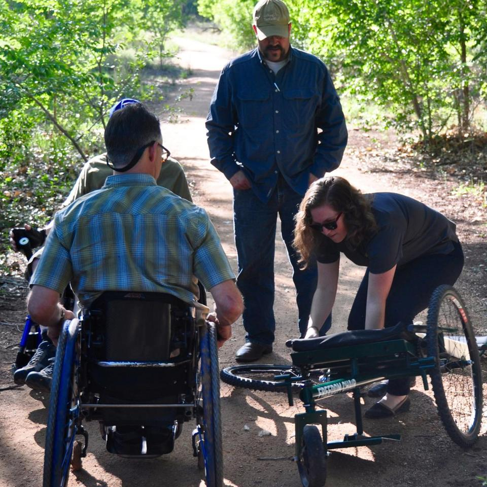 Tish Scolnik (right) was part of a team that designed the Freedom Chair. The wheelchair was built using bike parts to make it easier to navigate over rough terrain.